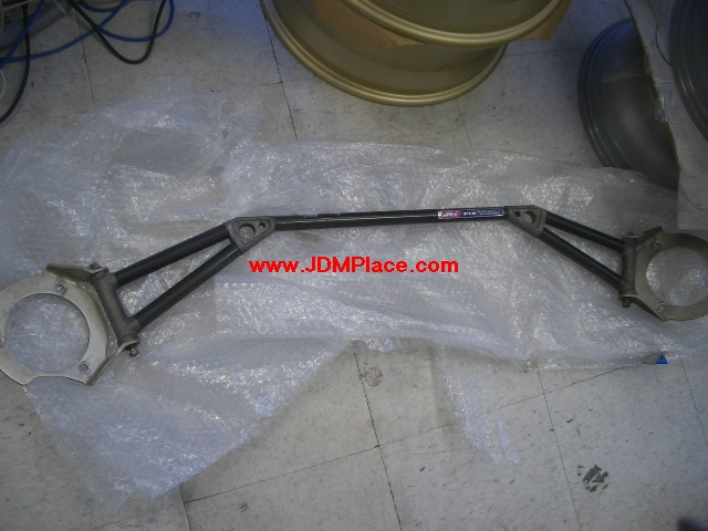 BR31XX1 - JDM Impreza STI Version 6 GC8 front carbon fiber strut bar, fits 93-01 Imprezas, 97-01 Foresters and 95-99 Legacys.